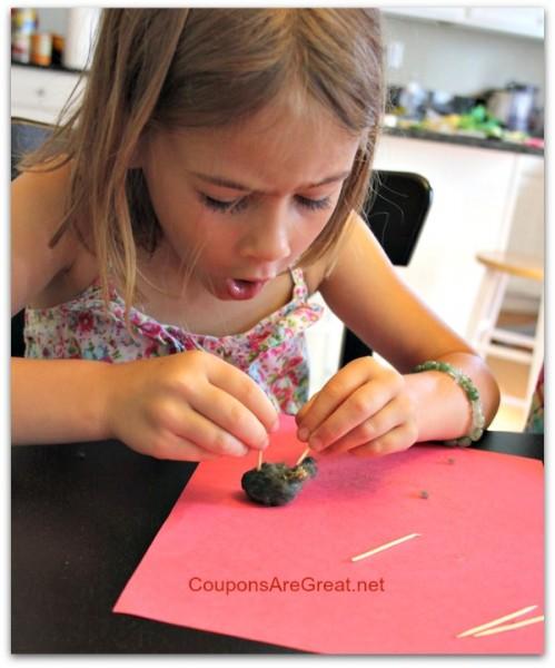 kid amazed dissecting owl pellet